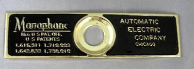 Automatic Electric Reproduction Top cradle badge